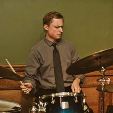 Tom Buckley playing drums.